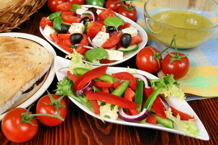 tomatos: Delicious vegetarian salads with tomatos, peppers, frisee lettuce