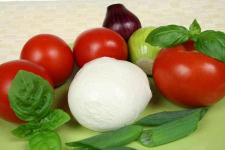 caprese: Caprese salad ingredients: tomatos, onions and mozarella cheese