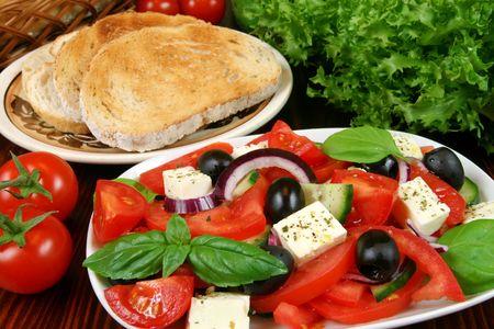 Greek salad with tomatos, mozzarella cheese, onions, olives
