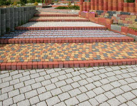 Betegeld, kleurrijke en decoratieve bestrating. Instelling blokken patroon. Stockfoto