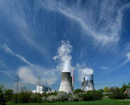 gigantesque: Gigantic power plant in Poland, fruit tree orchards and beautiful clouds