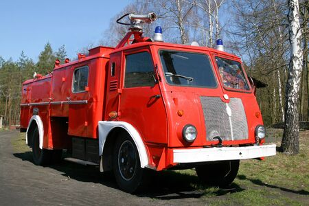 antique fire truck: Vintage fire fighting brigade . Old firefighting equipment. Stock Photo