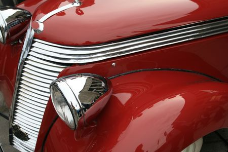 oldie: Vintage, shiny, red car. Classic luxury limousine. History of automobile.