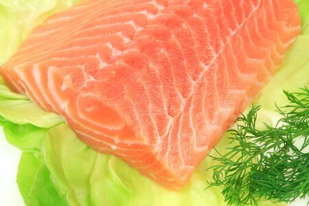 Raw salmon on lettuce with dill. Sea food.