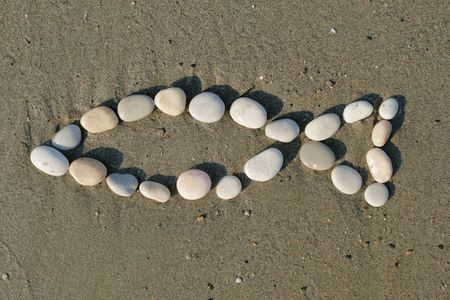 Christian symbol made of stones on sand - fish shape Stock Photo - 3417709