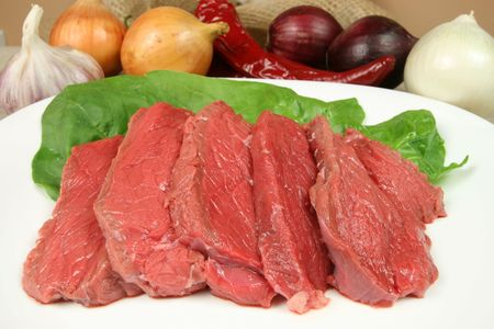raw beef: Fresh, raw beef meat prepared to be fried. Cuisine image. Stock Photo