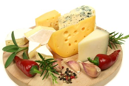 Cheese and herbs on a wooden board. Food photography. photo