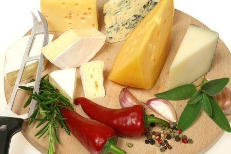 food photography: Cheese and herbs on a wooden board. Food photography.