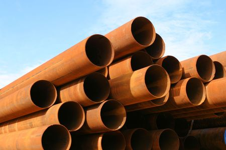 pipework: Rusty steel pipes, stacked against blue sky