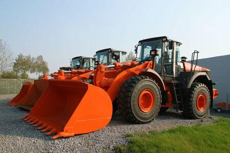 dozer: New, shiny and modern orange dozer machines. Construction industry machinery. Stock Photo