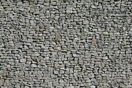 Granieten muur patroon. Natuur steen materiaal grens.  Stockfoto