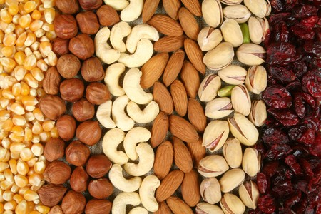 Nuts and corn - hazelnuts, cashews, almonds, pistachios background, dried cranberries. Dry food.