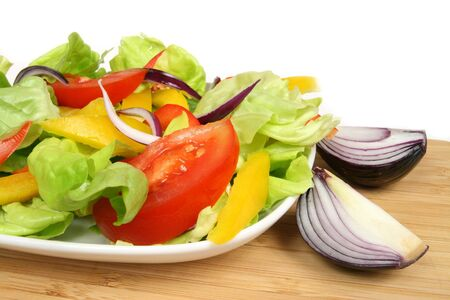 vegeterian: Colorful vegeterian salad with lettuce, onions, tomatos, peppers