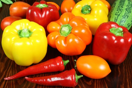 Vegetables on a table. Chili, peppers, tomatos, cucumbers. Stock Photo - 4211771