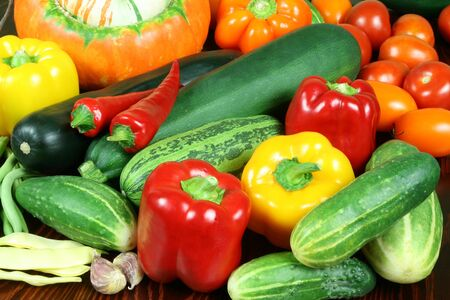 Vegetables on a table. Chili, peppers, tomatos, cucumbers. Stock Photo - 4211776