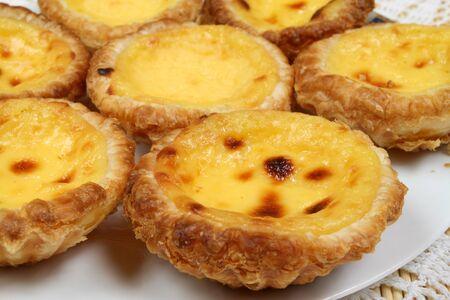 nata: Portugese pastries - pasteis de nata. Delicious home made cuisine. Typical for Lisbon region. Stock Photo