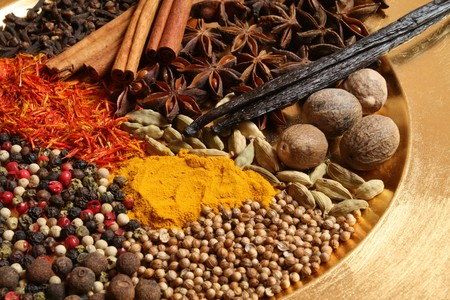 Spices - pepper, aniseed, cinnamon, cardamon and other ingredients on the golden plate. Stock Photo - 4419762