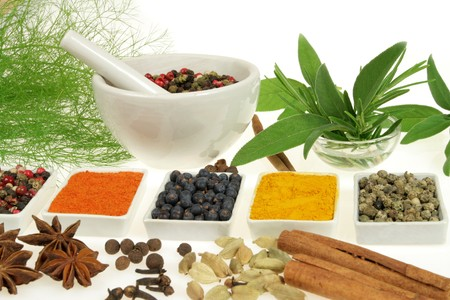 food additives: Whole variety of colorful spices. Assortment of cuisine ingredients in ceramic containers.