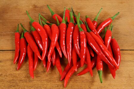 hottest: Red hot chilli peppers on the chopping board .