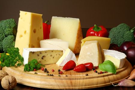 brie: Variety of cheese and vegetables: camembert, gouda, brie with nuts, parmesan, goat, sheep and other hard cheeses Stock Photo