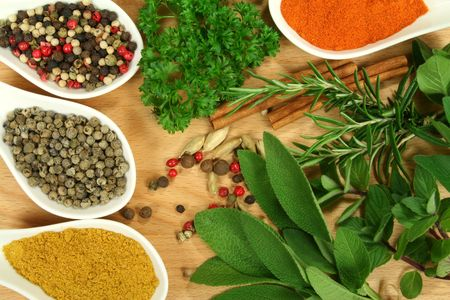 food additives: Herbs and spices composition. Cooking ingredients on a wooden table. Stock Photo