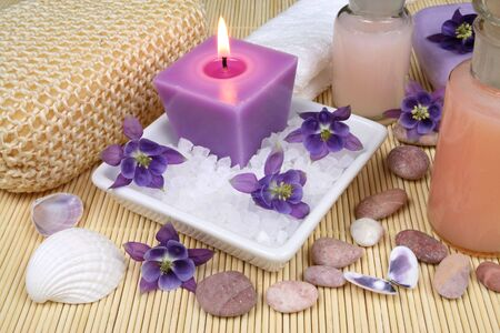 Spa resort treatment composition - flowers, candles and salt crystals photo