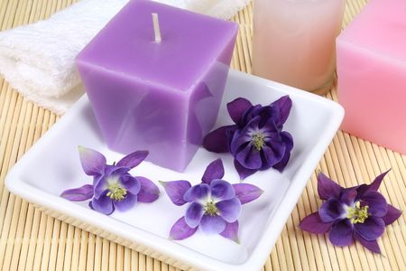 Spa resort treatment composition - flowers, candles and other details photo