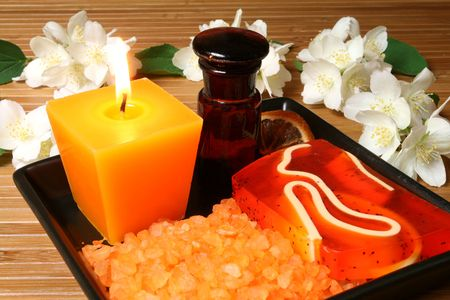 Spa resort therapy composition - jasmine flowers, candle and salt crystals photo