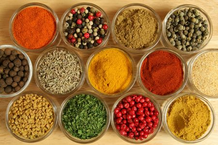 Spices and herbs in small glass bowls. Food and cuisine additives. Colorful natural ingredients. photo