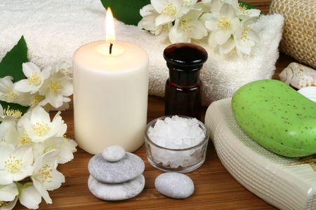 Spa resort therapy composition - jasmine flowers, soap, candle and salt crystals photo