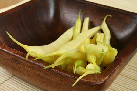 French beans in a wooden bowl. Food and cuisine. photo