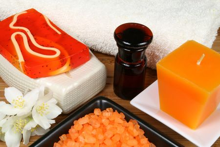 Spa resort therapy composition - jasmine flowers, fancy soap, candle and salt crystals photo