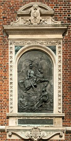 ornamented: King John III Sobieski of Poland. Bas-relief art on St. Marys Basilica exterior in Krakow.