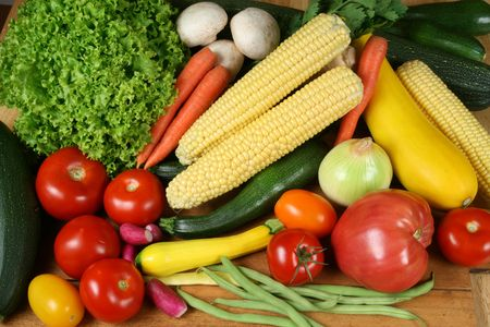 tomatos: Colorful choice of vegetables: tomatos, onion, corn, carrots, zucchini, lettuce, beans, radish, parsley and mushrooms