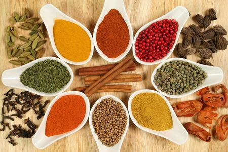 seasoning: Whole variety of colorful spices. Assortment of cuisine ingredients in ceramic containers.