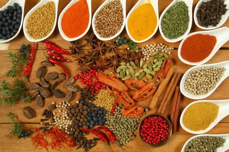 curry powder: Whole variety of colorful spices. Assortment of cuisine ingredients in ceramic containers.