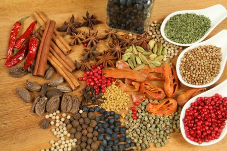badian: Whole variety of colorful spices. Assortment of cuisine ingredients in ceramic containers.