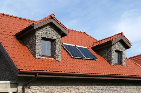 panel: Beautiful new home with solar panels on the roof - environmental friendly! Stock Photo