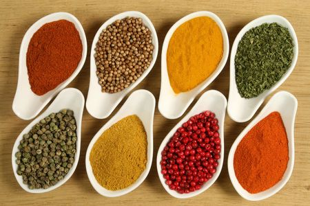 additives: Whole variety of colorful spices. Assortment of cuisine ingredients in ceramic containers.