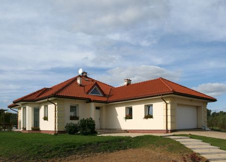 New beautiful house with red roof and garage. photo