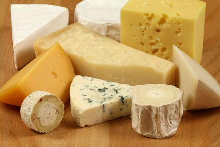 Variety of cheese: camembert, gouda, parmesan,  sheep and other hard cheeses Stock Photo
