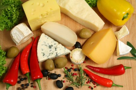 camembert: Variety of cheese: ementaler, gouda, Danish blue soft cheese, camembert, brie and other hard cheeses. Herbs and spices. Stock Photo