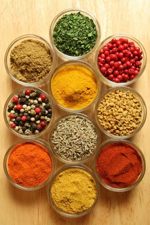 additives: Spices and herbs in small glass bowls. Food and cuisine additives. Colorful natural ingredients.