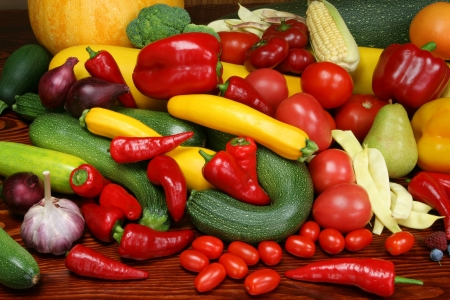 Organic produce. Autumn harvest - ripe vegetables and fruits. Tomatoes, plums, pepper, raspberries, zucchini, pears and other food. Stock Photo - 6139078