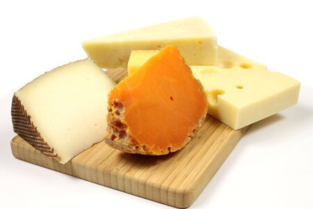 Variety of cheese: parmesan, mimolette, gouda and other hard cheese photo