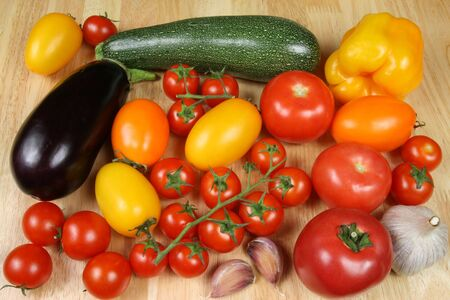 cherry varieties: Varieties of tomatos: red, orange, cherry, round and oval. Other vegetables: garlic, aubergine, courgette (zucchini)