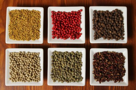 fenugreek: Colorful spices in rectangular ceramic containers - beautiful kitchen image.