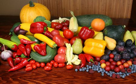 Autumn harvest - ripe vegetables and fruits. Organic produce. Tomatoes, onion, plums, pepper, raspberries, zucchini, pears and other food. photo