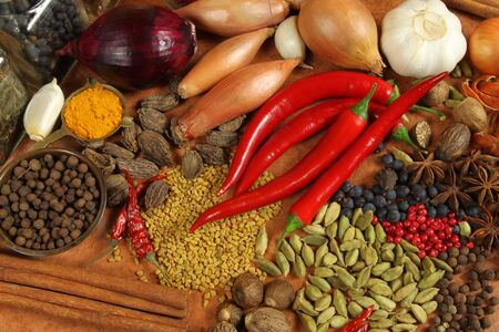 spices: Spices and herbs variety. Aromatic ingredients and natural food additives. Cuisine elements. Stock Photo