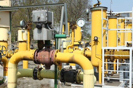 Gas pipeline. Yellow steel pipes. Industrial area detail. photo